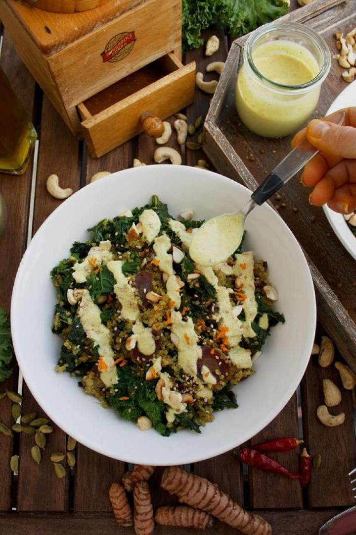 Kale salad with chicken and sunflower turmeric vinaigrette